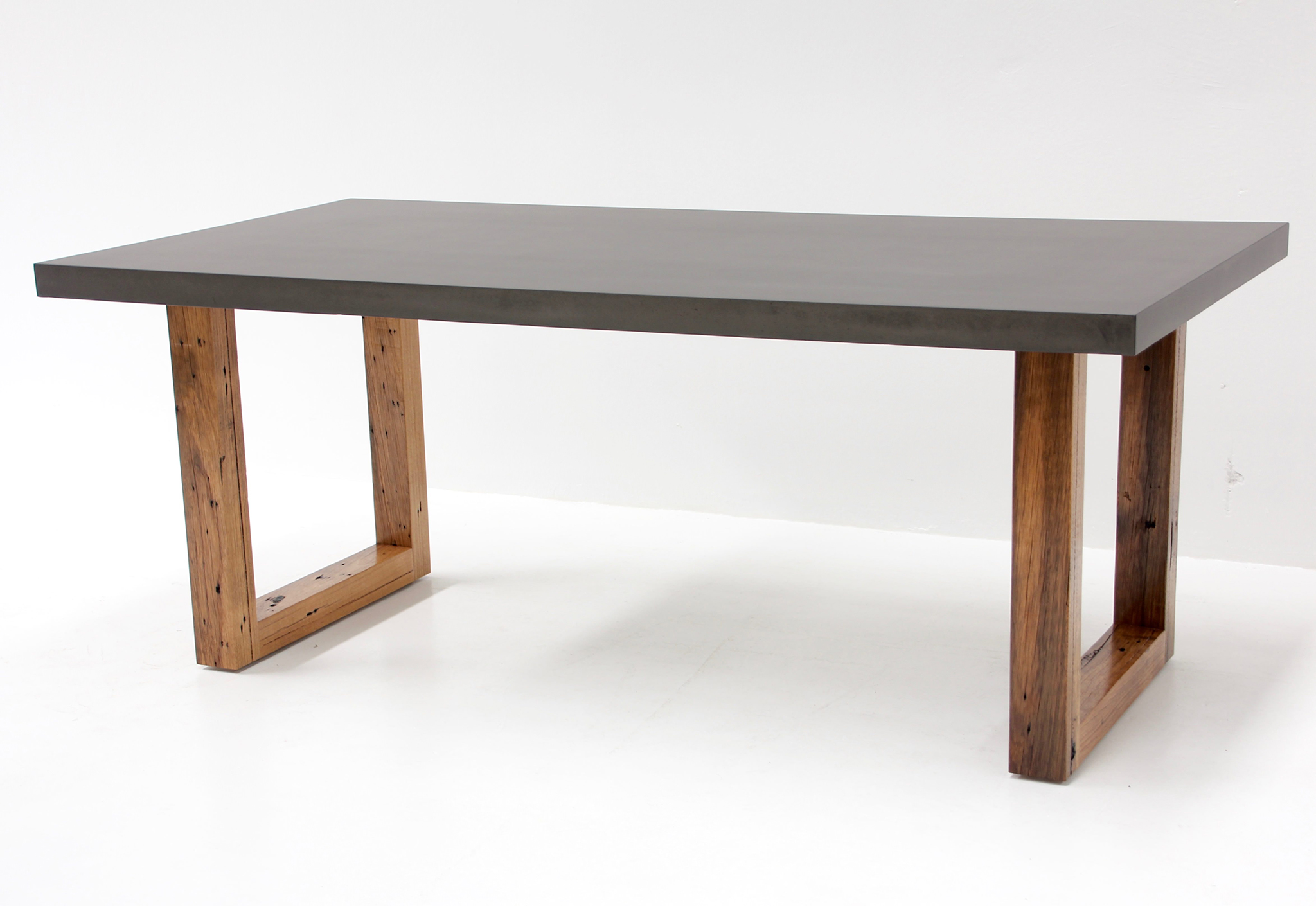 concrete table with hardwood legs. Black Bedroom Furniture Sets. Home Design Ideas